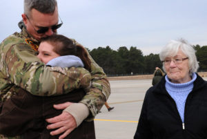 Deploying to Afghanistan – NJ Army National Guard hug family members at the Army Aviation Support Facility at Joint Base McGuire-Dix-Lakehurst