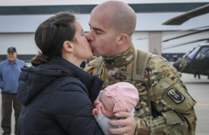 New Jersey Army National Guard deploying to  Afghanistan kisses his wife and daughter good-bye