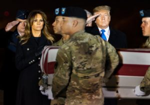 President Donald J. Trump salutes and First Lady Melania Trump places her hand over her heart during the dignified transfer